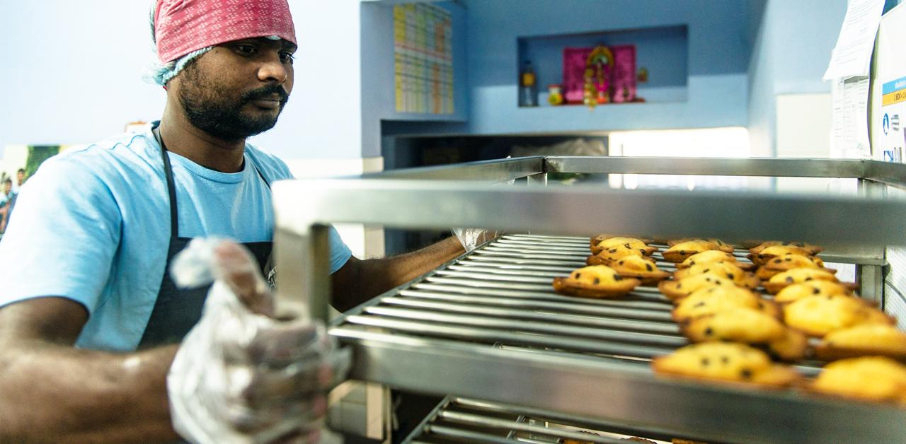 Shuktara Cakes - Sanjay, checking the madeleines
