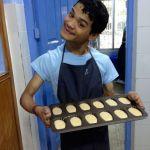 Shuktara Cakes - Ashok holding a tray of madeleine