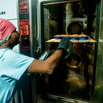 Shuktara Cakes - Sanjay removing the finished product