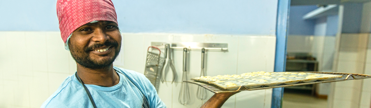Shuktara Cakes - Sanjay ready to put this tray in the oven